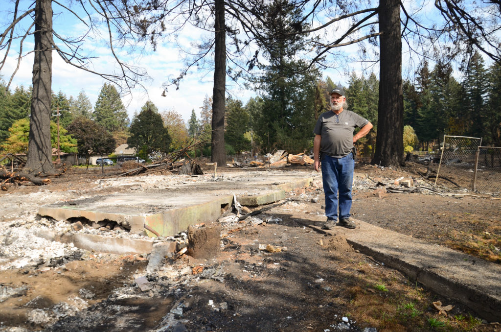 Michael Chauran stands near the remains of his home on Sept. 21, 2020 in Mehama, Oregon following the devastating wildfires that ravaged much of the state. Photo by Lynette Nyman/American Red Cross.
