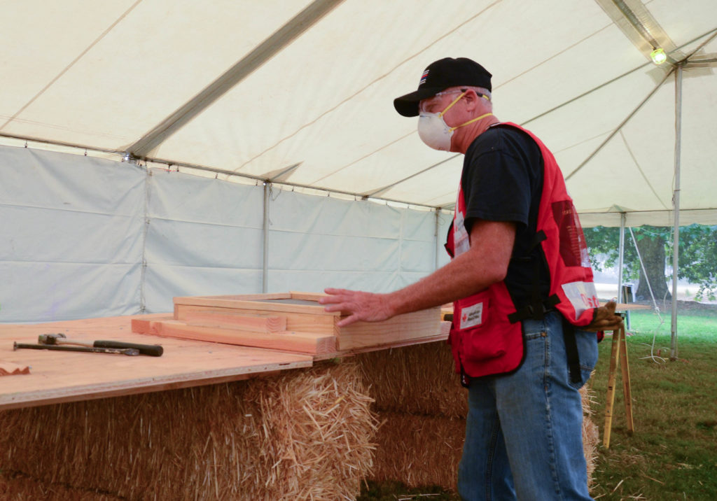Rick Williams assembling sifters in Silverton, Oregon on Sept. 14, 2020 following devastating wildfires in the state. Photo by Lynette Nyman/American Red Cross.