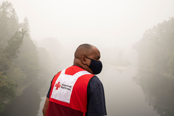 Eric Carmichael of the American Red Cross looks out over miles of burned forest along a road in Clackamas County, OR. The state of Oregon has been devastated by wildfires that continue to burn in many parts of the state.
