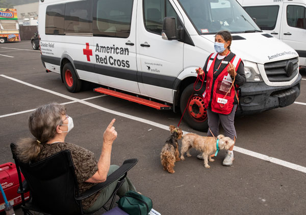 American Red Cross volunteer Sharon Izzo talks Elise Dirlam at an American Red Cross command post and shelter in Salem, OR on Sept. 15, 2020. Photo by Scott Dalton/American Red Cross.